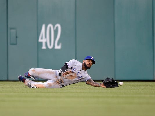 Texas Rangers center fielder Delino DeShields misses a line drive by Washington Nationals' Daniel Murphy for a single during the fourth inning of a baseball game, Friday, June 9, 2017, in Washington. (AP Photo/Nick Wass)