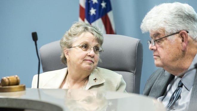 """Greg Miller, president of the state Board of Education, is resigning from the board """"effective immediately."""" He is shown with state schools Superintendent Diane Douglas, with whom he has been publicly feuding."""