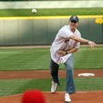 Chris Mack throws out first pitch for Reds' Triple-A affiliate Louisville