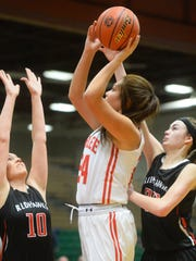 Arlee's Alyssia Vanderburg shoots over Medicine Lake-Froid defenders.