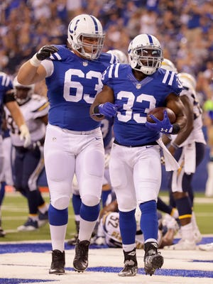 Indianapolis Colts running back Robert Turbin (33) celebrates after scoring a touchdown during the second half of an NFL football game Sunday, Sept. 25, 2016, at Lucas Oil Stadium.