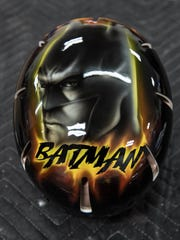 A custom painted Batman helmet done by Springfield-based