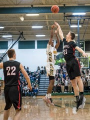 Marshall's Jack Luciani goes up to block a shot as