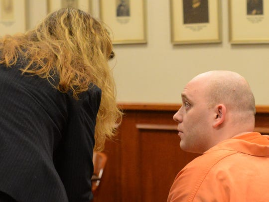 Kenneth Stahli, right, confers with his attorney MariAnn Connolly Friday afternoon.