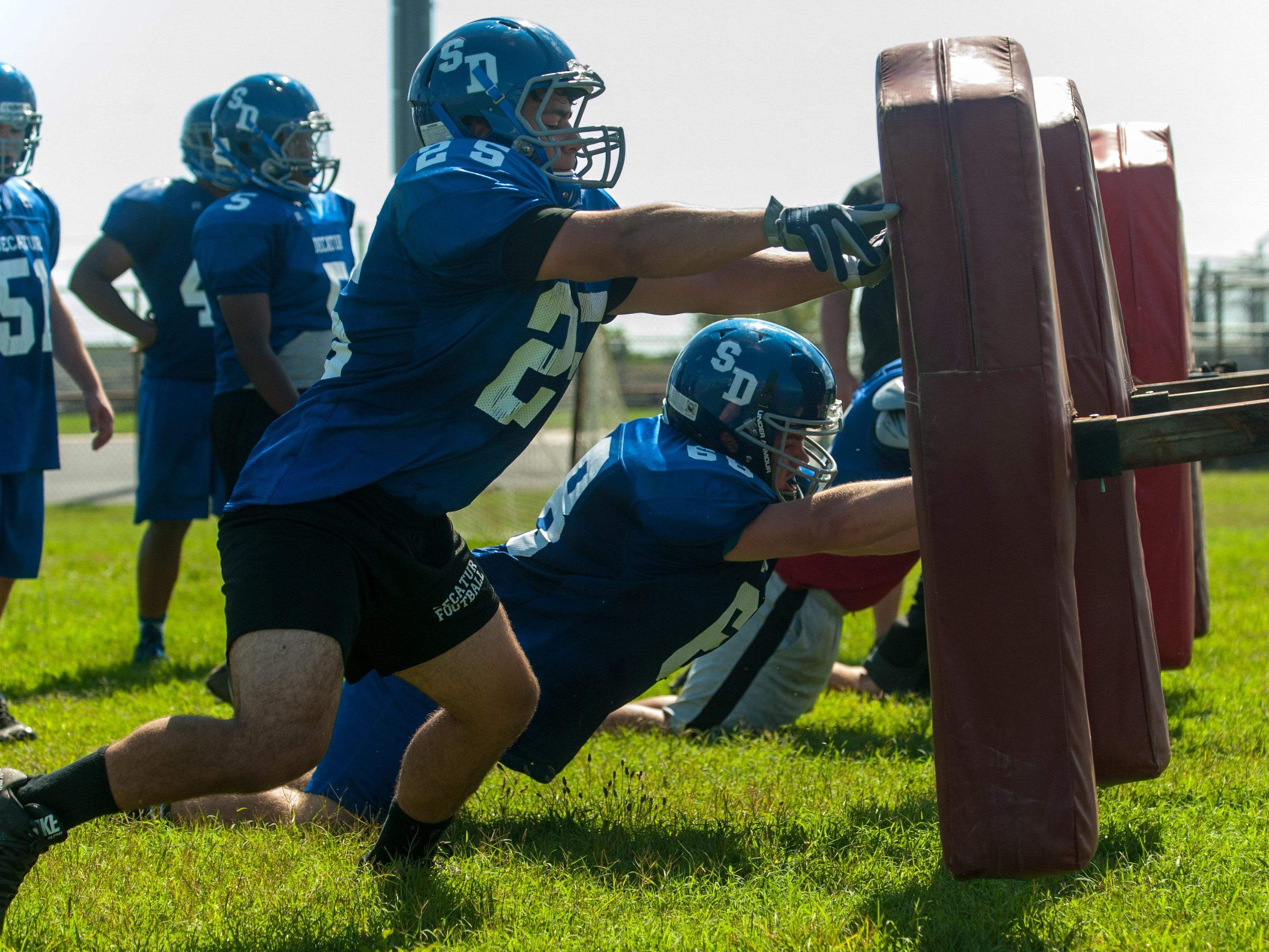 Stephen Decatur linemen work on their punch during practice on Friday morning in Berlin.