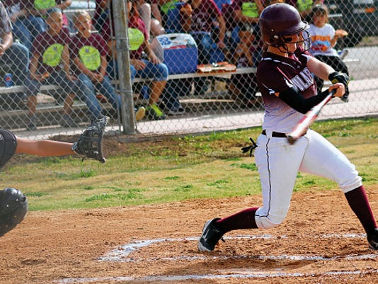 Jade Yousif swings at a pitch on Tuesday afternoon at the Tularosa High School softball field.