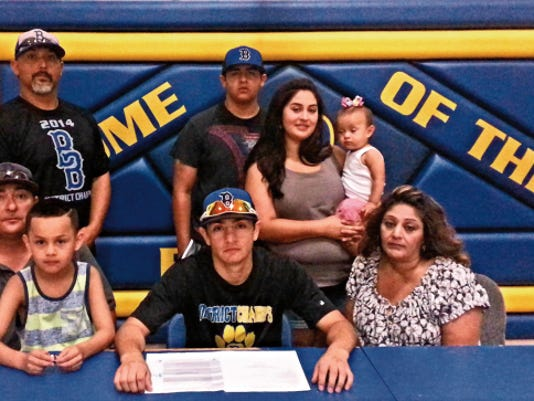 Bloomfield's Donny Trujillo, center, committed to play baseball for the Luna Community College Rough Riders on Monday at Bloomfield High School.