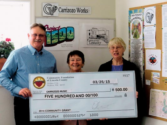John Hemphill, Community Foundation of Lincoln County board member, with Elaine Brannen and Barbara Culbertson who are co-chairs of Carrizozo Music.