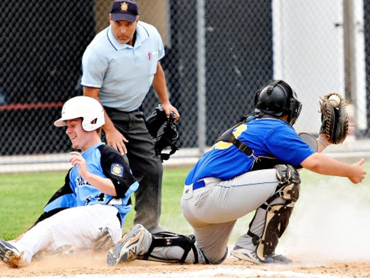 Pleasureville's Colin Parks, right, forces out South Western's Matt Taylor at home plate during York-Adams American Legion baseball action in Hanover on Thursday.