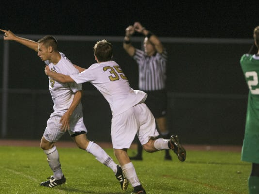 Elco's Blaine Troutman (left) and Justin Kimmet (35) celebrate Troutman's game-winner in the Raiders' double-overtime defeat of Donegal on Wednesday.