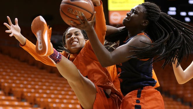 UTEP freshman guard Rachel Tapps, left, battles for a rebound against freshman forward Jessica Barbosa during their practice Tuesday at the Don Haskins Center.