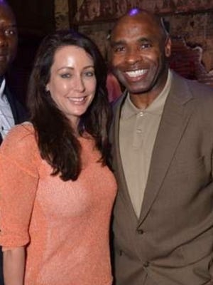 Tracy Blue and former U of L football coach Charlie Strong.