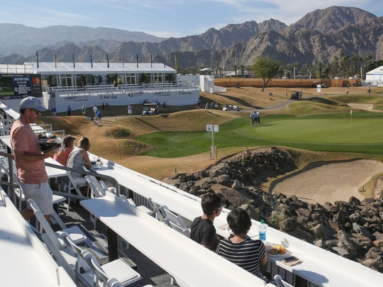 Fans enjoy the view from the Vons Pavilion at PGA West