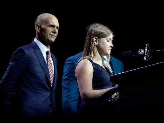 Kate Foster, 18, of Rockford, Ill., right, accompanied by former Chicago Bears center Jay Hilgenberg, announces Ashland's Adam Shaheen as the Bears' selection in the second round of the 2017 NFL football draft, Friday, April 28, 2017, in Philadelphia. (AP Photo/Matt Rourke)