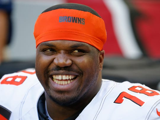 In this Dec. 15, 2019, file photo, Cleveland Browns offensive tackle Greg Robinson smiles during an NFL football game against the Arizona Cardinals in Glendale, Arizona. Robinson was being held Wednesday, Feb. 19, 2020, in the El Paso County Jail on a drug distribution charge from a federal agency, records show. Robinson, 27, was booked Tuesday, according to El Paso County Jail records.