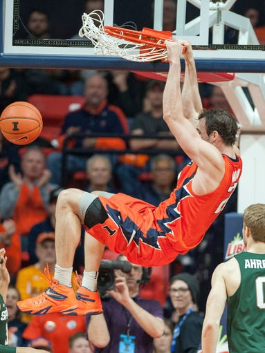 Illinois center Maverick Morgan (22) dunks over Michigan