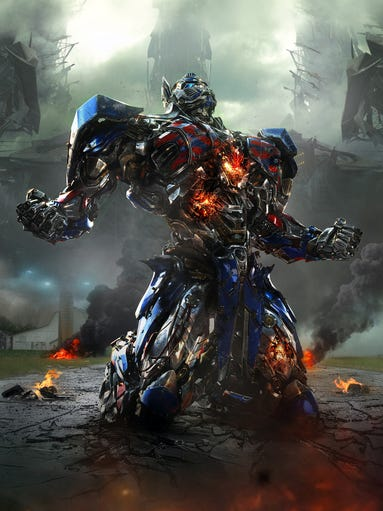 "Optimus Prime returns in ""Transformers: Age of Extinction."" Director Michael Bay says a different look was required for his heroic character in this fourth installment. ""It's like Batman with a new suit. We needed to change the look from top to bottom,"" says Bay."