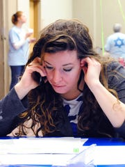 Ashley Conner, a member of YLD, makes calls to raise money at Super Sunday, an annual phone-a-thon fundraiser at the Jewish Federation of Greater Indianapolis.