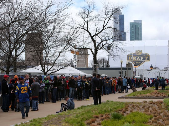 Fans line up to enter Draft Town before the 2015 NFL
