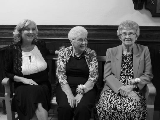 Aaron Young's mother, Angela Klier-Young, and grandmothers Shirley Klier and Virginia Kail pose for a photo in September 2013.