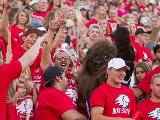 Members of the Dixie State administration present the new mascot, Brooks the Bison, to the student body during their game against New Mexico Highlands at Legend Solar Stadium Thursday, Sept. 1, 2016. DSU earned an award for its rebranding to the Trailblazers.