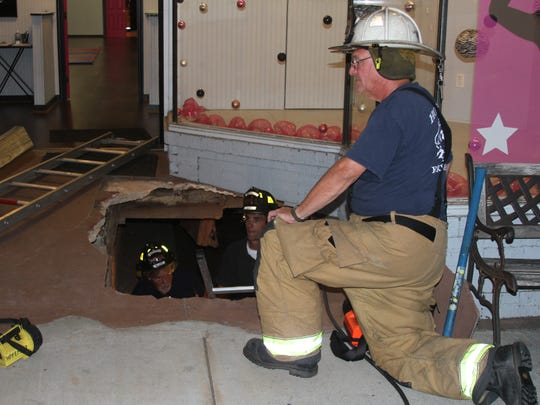 Honea Path firefighters work in a hole after part of