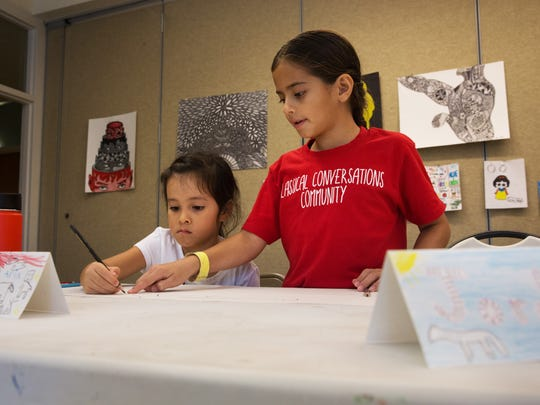 Jordan Gamez, right, helps Aria Richter with her perspective drawing during the Elementary Art Adventure class with the Naples Art Association at The von Liebig Art Center in October.