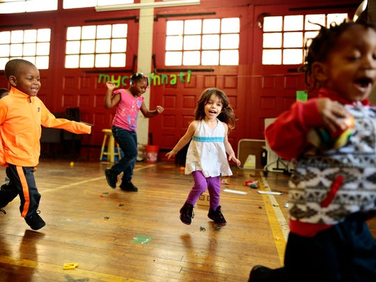 Children run and play tag in the daycare while their mothers rehearse upstairs during an acting class at the Warsaw Avenue Firehouse in the Price Hill neighborhood of Cincinnati on Thursday, April 20, 2017. Queen City Flash, sponsored by Cradle Cincinnati, meets with groups of women in Price Hill to produce original plays taking on issues that affect their community. An upcoming performance is focused on infant mortality.