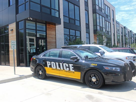 A police car sits outside the University Heights Police