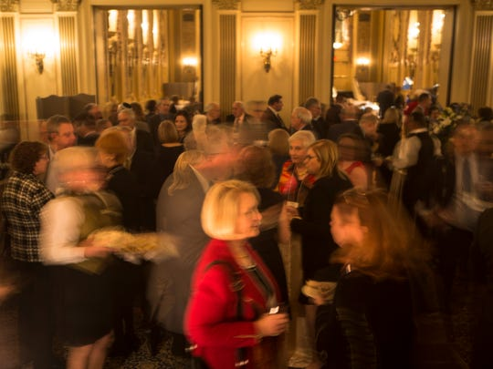People mingle and chat during the cocktail hour before the Jewish Federation of Delaware CHAI Event featuring guest speaker and Israeli Ambassador to the United States Ron Dermer Monday night in the Gold Ballroom at Hotel du Pont.
