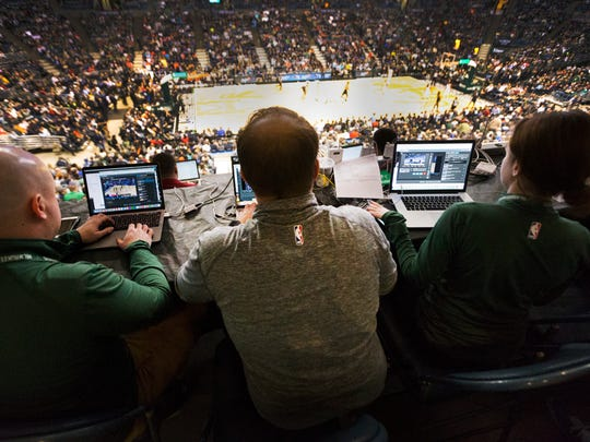 Seated high in the press row, Milwaukee Bucks digital