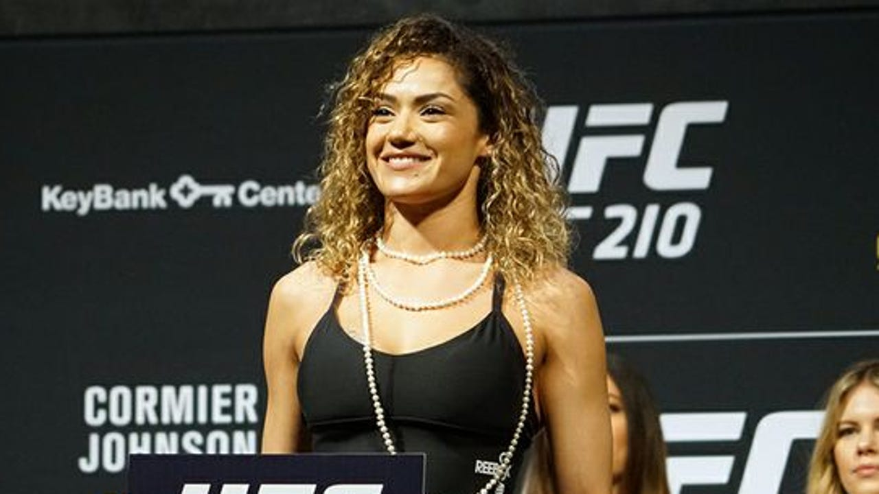 After her breast implants caused her to be removed from and then reinstated for UFC 210, Pearl Gonzalez said she'll try to put the attention to good use.