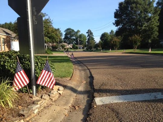 American flags line the road in Brandon on 9/11/14.