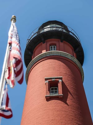 The American flag hangs beside the Inlet Lighthouse in Ponce Inlet. The historic lighthouse will host patriotic activities for Independence Day from noon to 2 p.m.