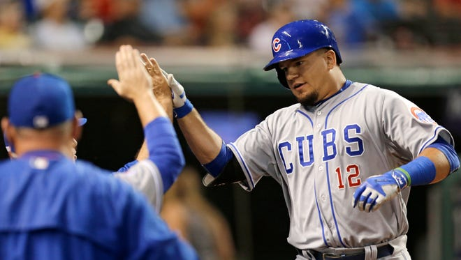 Chicago Cubs' Kyle Schwarber, right, is congratulated by teammates after Schwarber hit a two-run home run off Cleveland Indians starting pitcher Danny Salazar during the fifth inning of a baseball game, Thursday, June 18, 2015, in Cleveland.