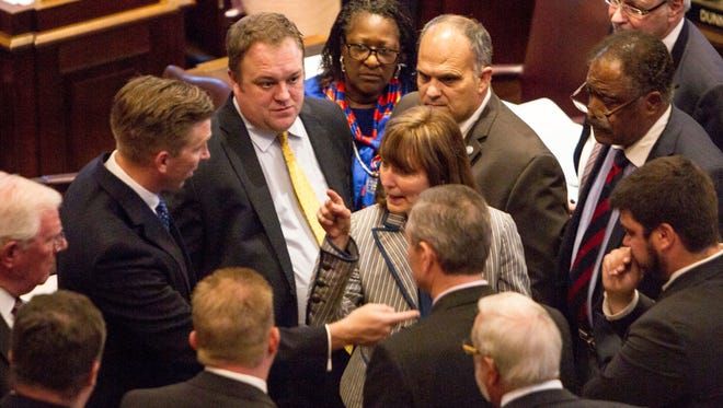 House Speaker Beth Harwell, R-Nashville, center, speaks with representatives and staff on the House floor in Nashville on Thursday, May 4, 2017. The chamber delayed a vote on the state's annual spending plan amid deep disagreements between Republicans over spending priorities.