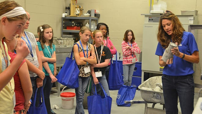 MTSU Concrete Industry Management Director Heather Brown, right, discusses the process for making concrete with girls attending a past Expanding Your Horizons in Math and Science event at MTSU.