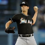 Marlins starting pitcher Justin Nicolino throws in