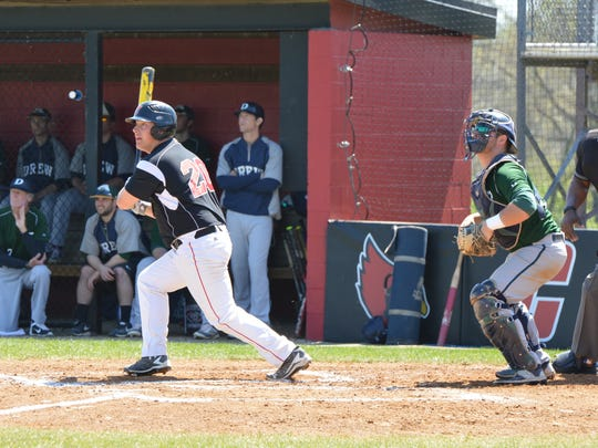Jake Crist laces a hit for Catholic University in a game against Drew. Crist is batting .359 and hass 25 RBIs.