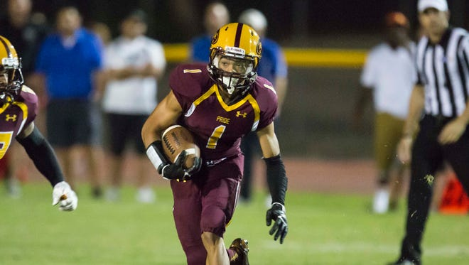 Mountain Pointe Senior Running Back Paul Lucas (1) looks up the field during the game against Chandler on Sept. 19th, 2014, in Phoenix.