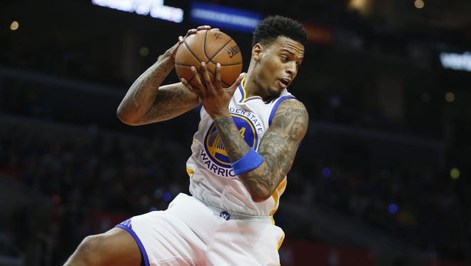 The Golden State Warriors' Brandon Rush brings in a rebound against the Los Angeles Clippers during the first half on Feb. 20 in Los Angeles.