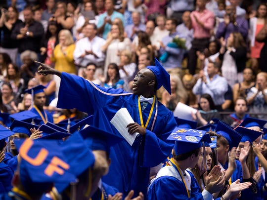Martin County High's Lovensky Gresseau, of Stuart, is acknowledged as part of a group of graduating seniors joining the military, following graduation, at the commencement ceremony May 23, 2017, at the school in Stuart.
