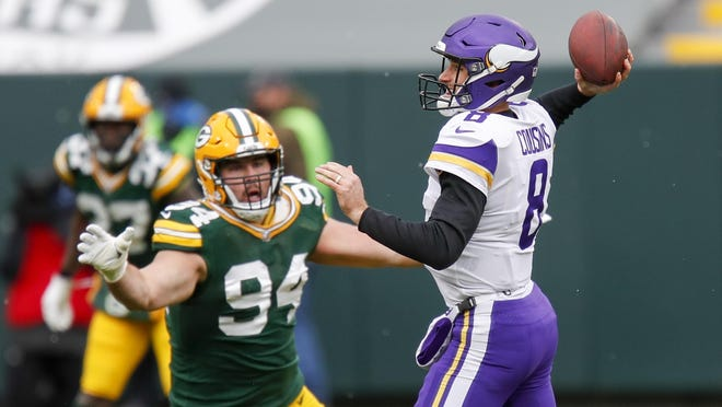 Minnesota Vikings quarterback Kirk Cousins looks to get rid of the ball as Green Bay Packers defensive lineman Dean Lowry closes in on Sunday, Nov. 1, 2020, in Green Bay, Wis. Lowry, the former Boylan standout, will try to tackle another Rockford product, Jacksonville running back James Robinson, the former Lutheran star, this Sunday.