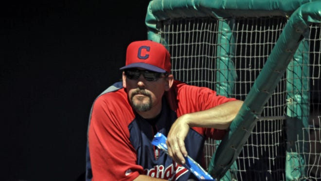Cleveland Indians hitting coach Ty Van Burkleo watches from the dugout during a spring exhibition baseball game against the Chicago White Sox Friday, March 14, 2014, in Glendale, Ariz.