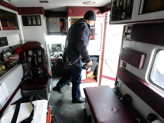 Lancaster firefighter Kevin Nagle walks out of the