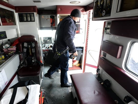 Lancaster firefighter Kevin Nagle walks out of the back of an ambulance as he and his coworkers on Lancaster Medic 2 respond to a call on the city's southwest side Friday, Jan. 5, 2018, in Lancaster.