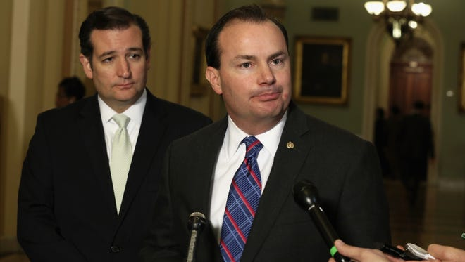Sen. Ted Cruz, R-Texas, left, and Sen. Mike Lee, R-Utah, talk to reporters on Capitol Hill.