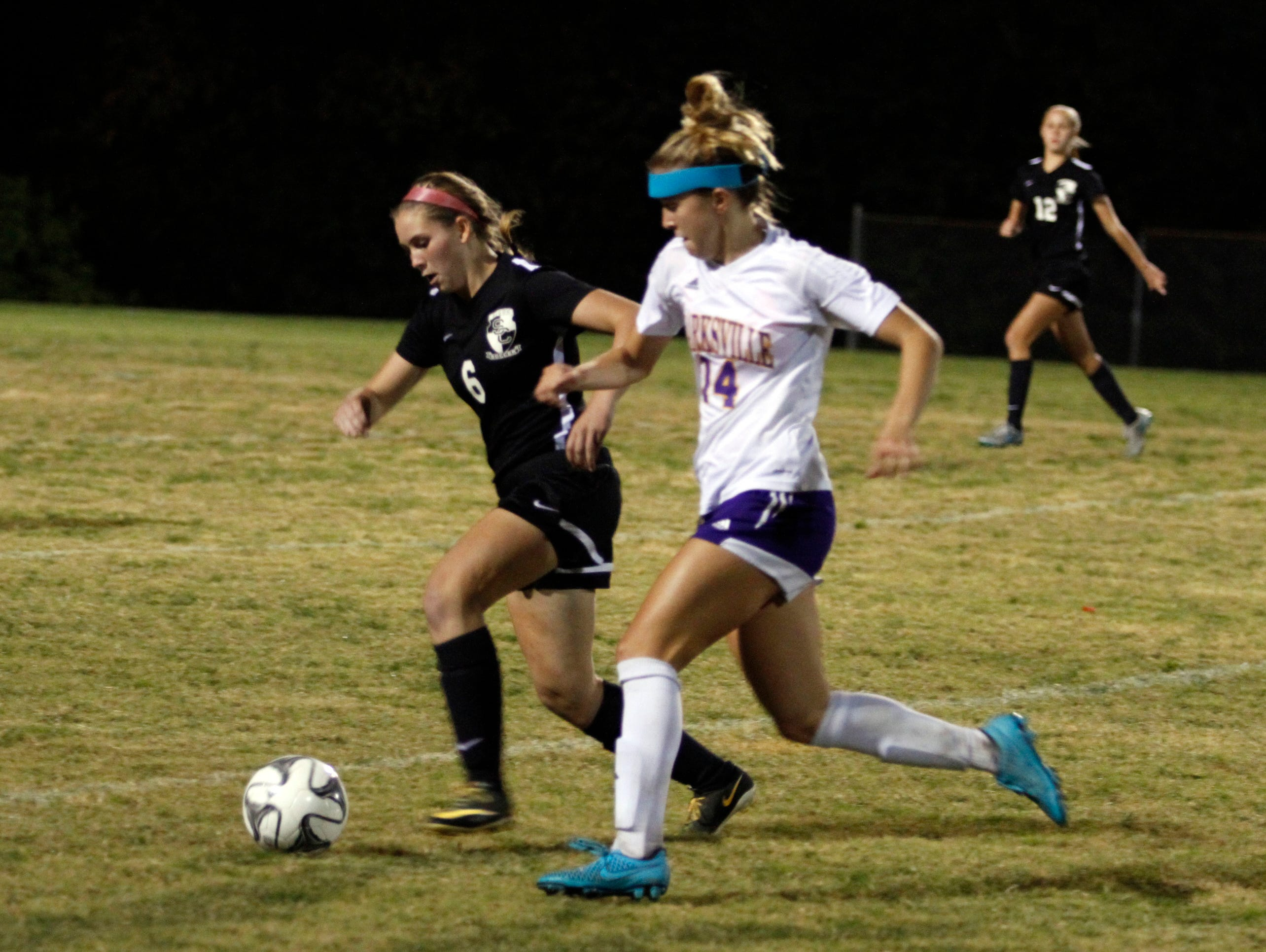 Clarksville High's Salera Jordan (14) tries to gain control of the ball from the midfield during their Region 5 soccer tournament semifinal Tuesday night at CHS.