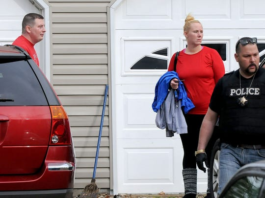 Brian and Katie McConnell leave their Ontario home on November 6, 2015 after being held hostage along with their two children. Brian was forced to take money from the Key Bank branch in Ontario he managed while his family was held by gunman. Jason J. Molyet/News Journal
