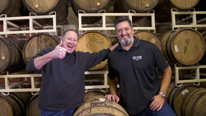 Andy Goeler, Anheuser-Busch InBev. CEO of Craft The High End, left, and Andy Ingram, Four Peaks Brewery co-founder, announce that Anheuser-Busch InBev., world's largest brewer has purchased Tempe's Four Peaks Brewing Co. on Friday, Dec. 18, 2015.